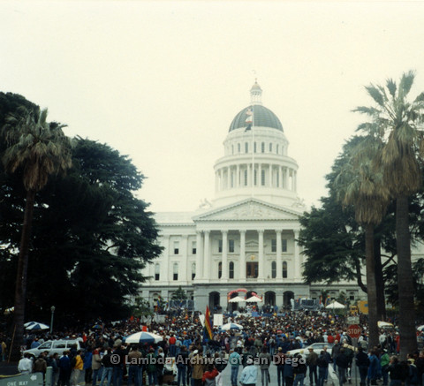 P019.146m.r.t March on Sacramento 1988 / Pre Parade gathering: Crowd of people gathered in front of City Hall