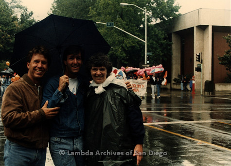 P019.391m.r.t March on Sacramento 1988: Jeri Dilno standing on street with two men