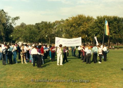"P019.281m.r.t Second March on Washington 1987: People marching on street, banner reads: ""ATLANTA FEMINIST WOMEN'S CHORUS"""