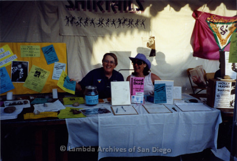 San Diego Pride Festival, July 1992: Partners Sheila Clark (left) and Judy Reif (right) at the Shirtails Dances booth