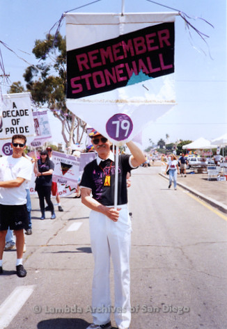 P018.121m.r.t San Diego Pride Parade 1994: C. David Hollenbeck holding Lesbian and Gay Archives banner