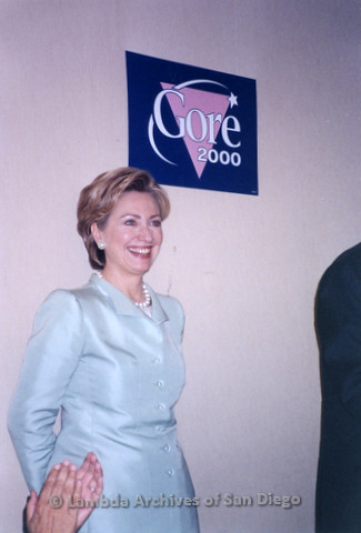 P338.040m.r.t 2000 Democratic National Convention Los Angeles: Hillary Clinton standing under Gore 2000 sign at the Gay Caucus meeting
