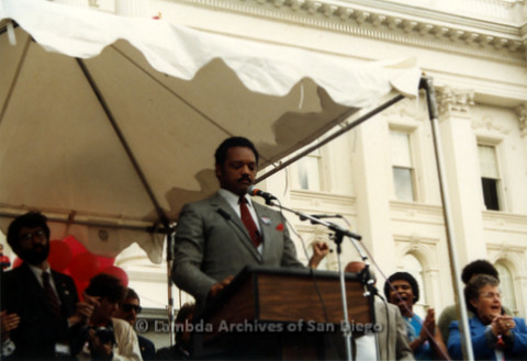 P019.126m.r.t March on Sacramento 1988 / Pre Parade gathering: Jesse Jackson speaking on stage in front of City Hall