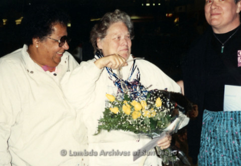 """""""The Magic Music Makes"""" San Diego Women's Chorus (SDWC) first choral festival with Sister Singers 1991: Chorus Director Cynthia Lawrence Wallace (left) hugs Partner Peggy Heathers"""