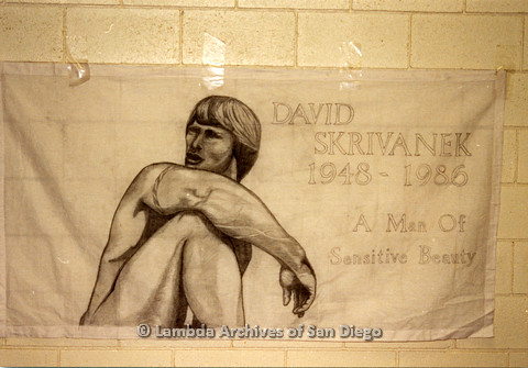 P019.043m.r.t AIDS Quilt at San Diego Golden Hall 1988: White quilt decorated with a scetched man dedicated to David Skrivanek
