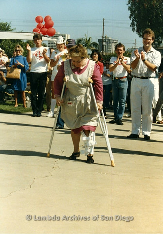 "P012.024m.r.t San Diego Walks for Life 1986: Zelda ""Mother"" Rubenstein walking on crutches"