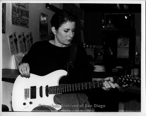 """March 1989 - """"So Many Women"""" Video Shoot: Zanne Seated at The Bar Area at The Flame, Lesbian Dance Club."""