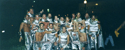 P184.013m.r.t Nightmare On Normal Street: Group photo of men in various matching metallic silver outfits.