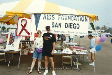 P197.028m.r.t AIDS Walk San Diego 1993: Sharon Parker and Patrick Stevens in front of AIDS Foundation San Diego booth