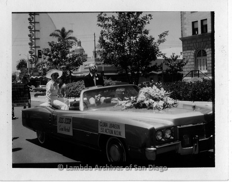 1977 - San Diego Lambda Pride Parade: Grand Marshals Jess Jessop (right) and Gloria Johnson (left) seated in the back seat.