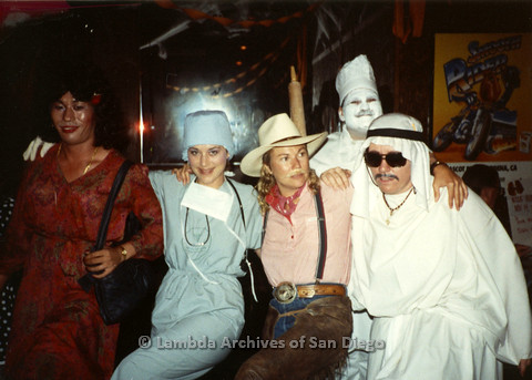 P099.088m.r.t Halloween: Five people in costumes: red dress, surgeon, cowboy, baker, and Arab