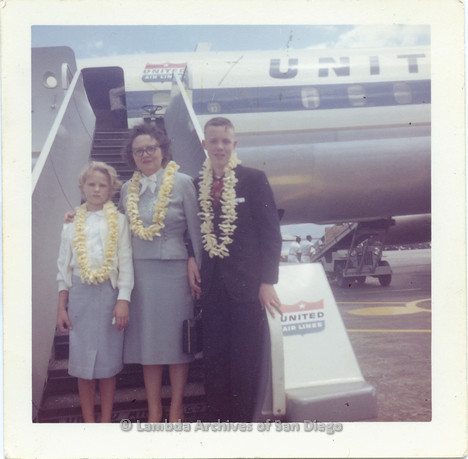 P338.090m.r.t Young Charles McKain on vacation in Hawaii with his family in front of an airplane