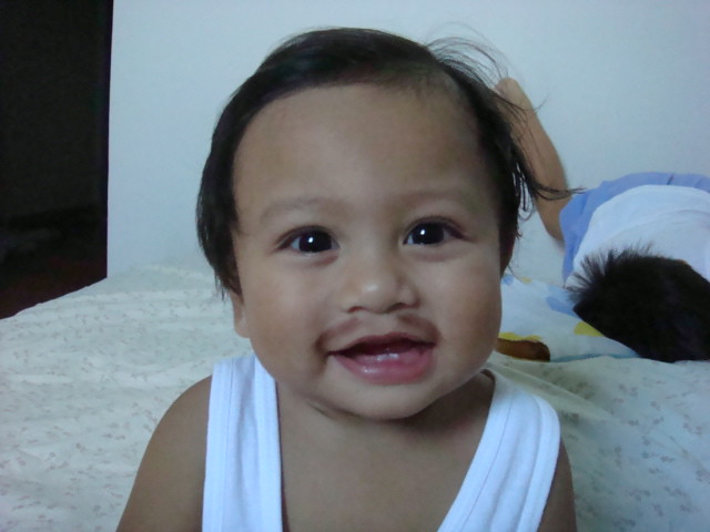 the baby with mustache