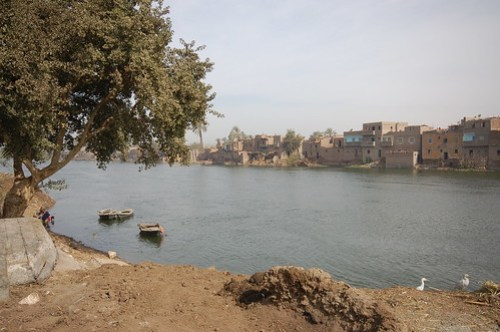 Riverside settlements and boats by the Nile