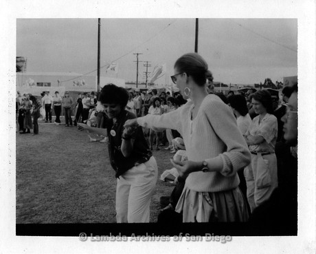 1977 - San Diego Lambda Pride Festival: Lambda Pride Board Member Jeri Dilno (center left) dancing with another Lesbian at the LGBT Pride Festival.