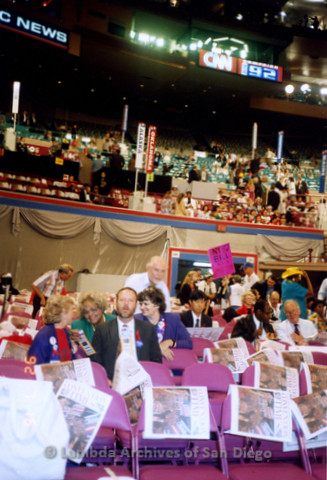 P338.046m.r.t 1992 Democratic National Convention New York: Crowd sitting in pink chairs, including Charles McKain (front) and Jeri Dilno (directly behind Charles to right)