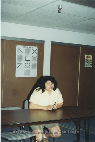 """P235.021m.r.t North County Center, San Diego: Cheli Mohamed sitting at a table in front of """"CENTER BINGO"""" sign"""