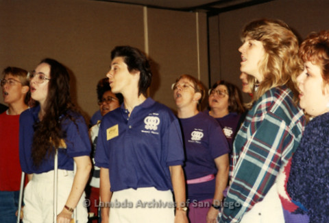 """""""The Magic Music Makes"""" San Diego Women's Chorus (SDWC) first choral festival with Sister Singers 1991: SDWC rehearsing, Deanne Gauthier (second right)"""