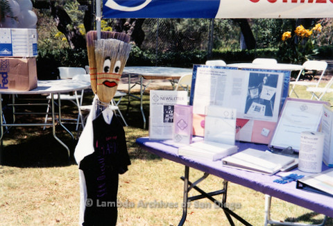 P018.168m.r.t San Diego Pride Festival 2000: Broom doll at LGHSSD display