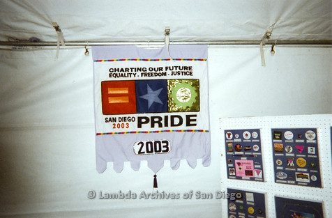 P096.004m.r.t LASD Pride Display: Pride Flag 2003 displayed inside LASD booth