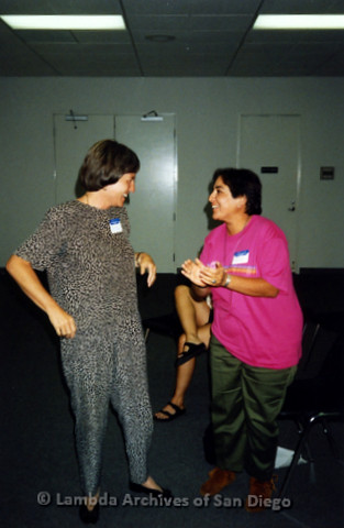 P341.013m.r.t Women's Caucus meeting: Roberta Achtenberg (left) and woman in pink applauding her