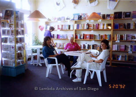 P167.007m.r.t Paradigm Women's Bookstore: Karen Merry sitting with another woman inside bookstore
