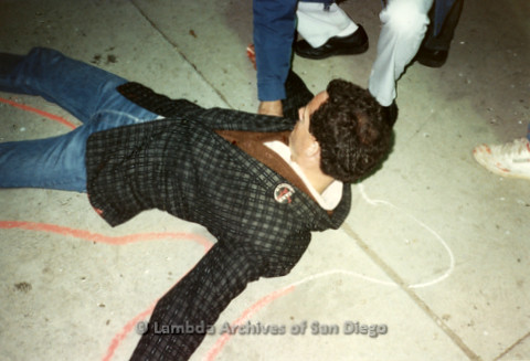 """P019.343m.r.t Los Angeles """"Die In"""" 1988: Man laying on ground with red chalk outline around him"""