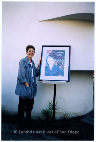 P200.026m.r.t LASD's 10th Anniversary at the Center: Karen Marshall standing next to portrait of Christine Kehoe