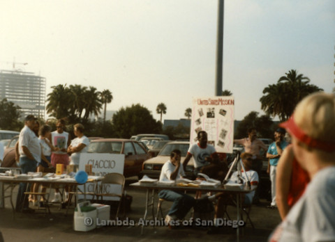 """P197.011m.r.t San Diego Walks For Life 1988: Organizations tabling in parking lot. One sign reads: """"United States Mission"""""""