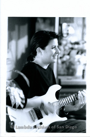 """March 1989 - """"So Many Women"""" Video Shoot: Zanne  Playing Her Guitar During Video."""
