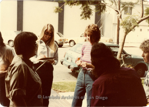 Blood Sisters blood drive, 1983: Lola Halpern (pink striped shirt), Peggy Skill and other women standing outside Blood Bank