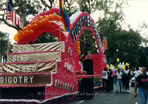 """P119.016m.r.t San Diego Pride: A parade float  decorated with the """"Together In Pride"""" theme"""