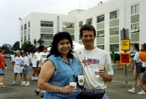 "P240.050m.r.t The Center at AIDS Walk 1994: Cheli Mohamed standing with a man, both wearing ""AIDS WALK"" t-shirts"