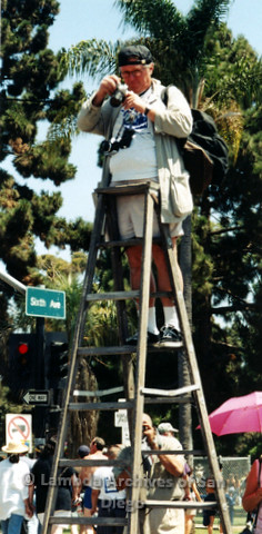 P119.070m.r.t San Diego Pride 1997: A man on a ladder taking photos