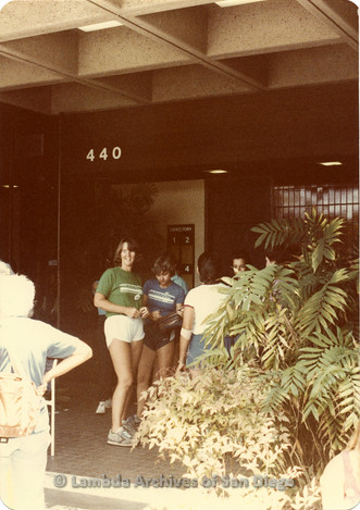 Blood Sisters blood drive 1983, Catherine Kroger (right) and Carol Adsit (left) standing in front of Blood Bank entrance