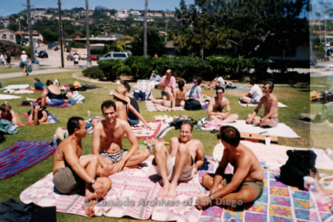 P239.034m.r.t Volunteer Picnic for The Center in La Jolla: Shirtless men lounging in sun, other people socializing
