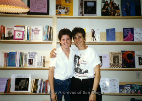 P169.050m.r.t Paradigm Women's Bookstore Grand Opening: Two women standing in front of books on shelves