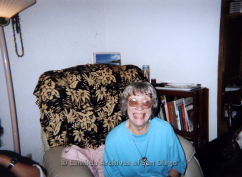 P338.088m.r.t Gloria Johnson wearing a blue shirt sitting on a couch and smiling