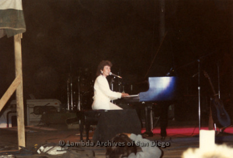 West Coast Women's Music and Comedy Festival, Produced by Robin Tyler in Yosemite, California, Labor Day Weekend 1991. Lesbian Performer, Lucie Blue Tremblay singing and playing a Grand Piano on the Festival Night Stage.