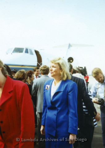P341.033m.r.t Unidentified woman in blue suit standing in front of airplane