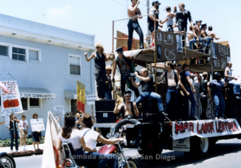 San Diego Lambda Pride Parade: Contingent - Gay Leathermen riding on the  Double Decker 'Hard Labor Leather' Float. Fundamentalist Christians Protesting in Background. Mark Holmes (seated Center), Owner Of Hard Labor Leather Stor