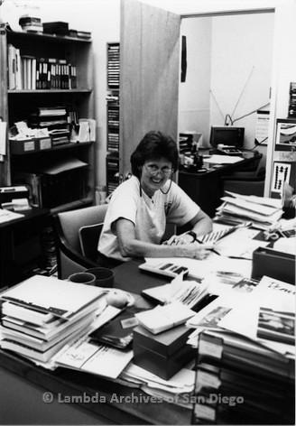 P167.102m.r.t Paradigm Women's Bookstore: Karen Merry working at her desk
