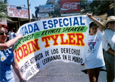 P018.141m.r.t Tijuana Pride Parade 1996: Robin Tyler keynote speaker banner in parade