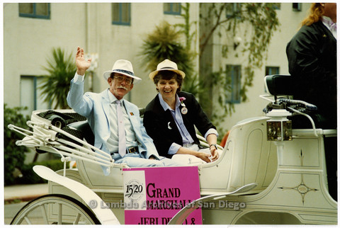 P201.001m.r.t San Diego Pride Parade 1989: Grand Marshalls Jess Jessop and Jeri Dilno riding in carriage and waving
