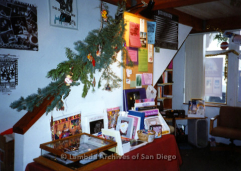 P168.054m.r.t Paradigm Women's Bookstore Kettner Location: Interior of bookstore with Christmas decorations on staircase