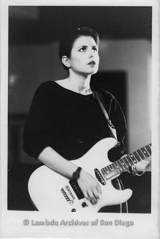 """March 1989 - """"So Many Women"""" Video Shoot: Zanne With Her Guitar, Looking off Camera."""