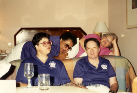 """""""The Magic Music Makes"""" San Diego Women's Chorus (SDWC) first choral festival with Sister Singers 1991: Couples, Cynthia Lawrence Wallace (back Left) and Peggy Heathers (Back Right) with Carol Reagan (Front Left) and Cathy Rockdashil sit on bed celebratin"""