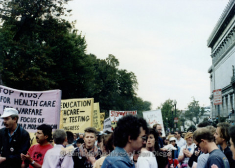 P019.237m.r.t Second March on Washington 1987: Men and women marching with various signage