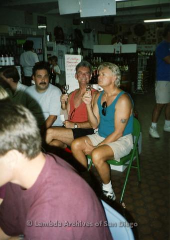 P099.040m.r.t Wine tastings: Three men sitting in wine shop holding glasses