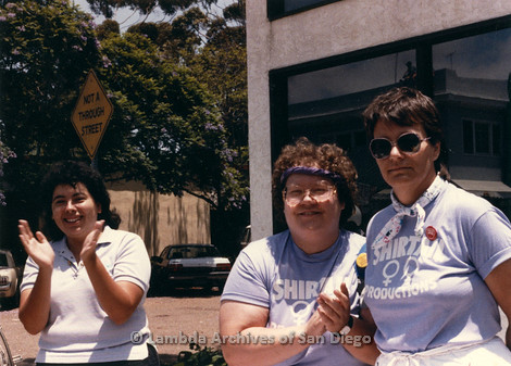 San Diego LGBTQ Pride Parade, July 1988: Three Shirtails Dance Volunteers watching the parade, Melba Garcia (left)